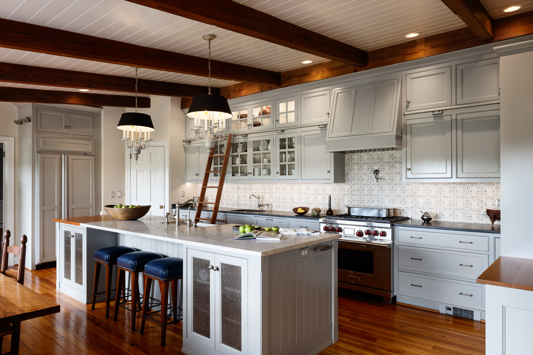Farmhouse kitchen renovation with Antique beams pulled from barn on the farm